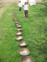 Children counting a neverending line of bowls |
