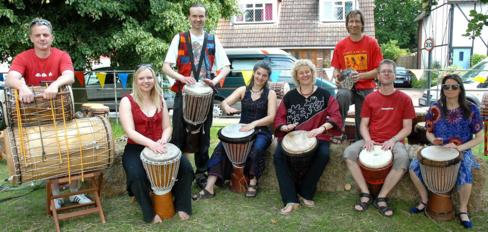 [ Secret Bass drum group at Little Berkhamsted Fete, photo by David Cory ]