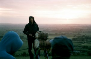 Ant from Vitae Drummers atop windswept Coombe Hill |