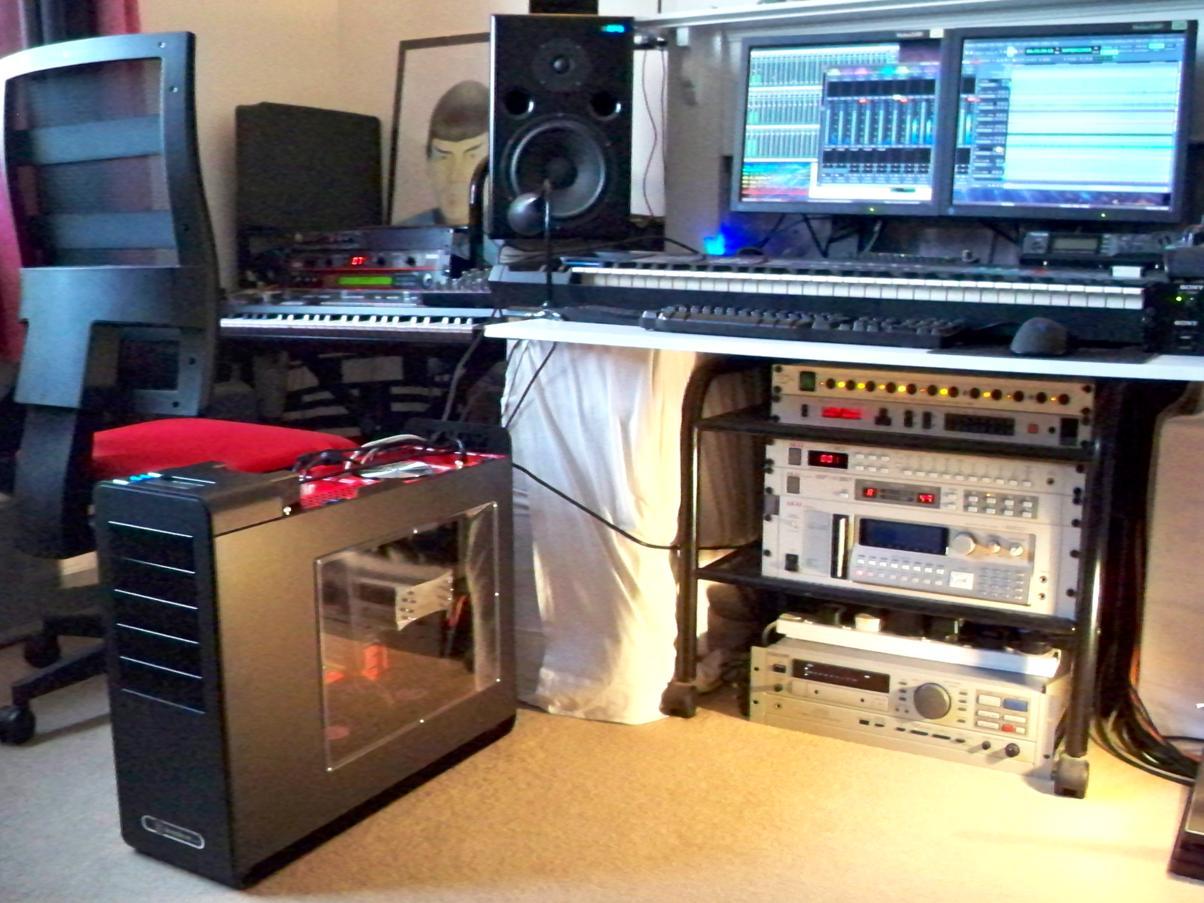 Low Side View Of Computer And Akai Rack Beneath Studio Desktop