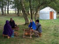 Playing balafons beside a yurt ]