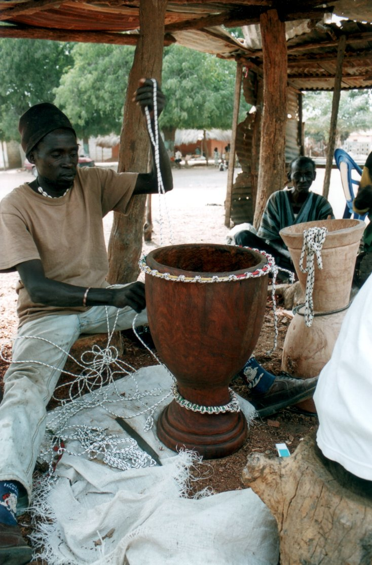 [ Master craftsman making a djembe in Senegal ]
